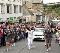 Who's that torch bearer? Bob Diamond? No it's that other fat cat Sir Martin Sorrell!
