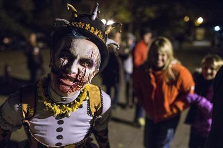 A costumed character entertains ticketed participants before they enter the haunted trail known as the 'Horseman's Hollow' on the grounds of the historic Philipsburg Manor in celebration of Halloween in Sleepy Hollow, New York
