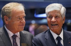 Omnicom Chief Executive Wren and Publicis Group Chairman and CEO Levy smile after announcing agreement on their merger on floor of New York Stock Exchange