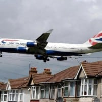 BRITISH AIRWAYS Boeing 747-400 Jumbo jet comes into land over rooftops of houses at the end of the south runway near Heathrow Airport. Protesters local residents and Green campaigners and local councilors have won a High Court battle to stop a third runway being built at Heathrow Airport this morning Friday 26th March  photo, copyright Gary Dawson 31 Old Bourne Way Great Ashby, Stevenage, Herts SG1 6AE  (m 07776 138143)